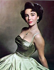 elizabeth-taylor-almost-17-sits-for-photographer-phillippe-halsman-in-a-decollete-evening-dress-of-gold-silk-387x500